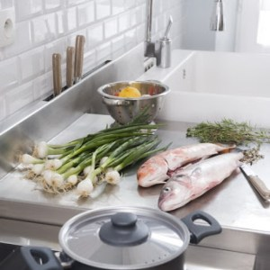 fish and green onions prepared for cooking