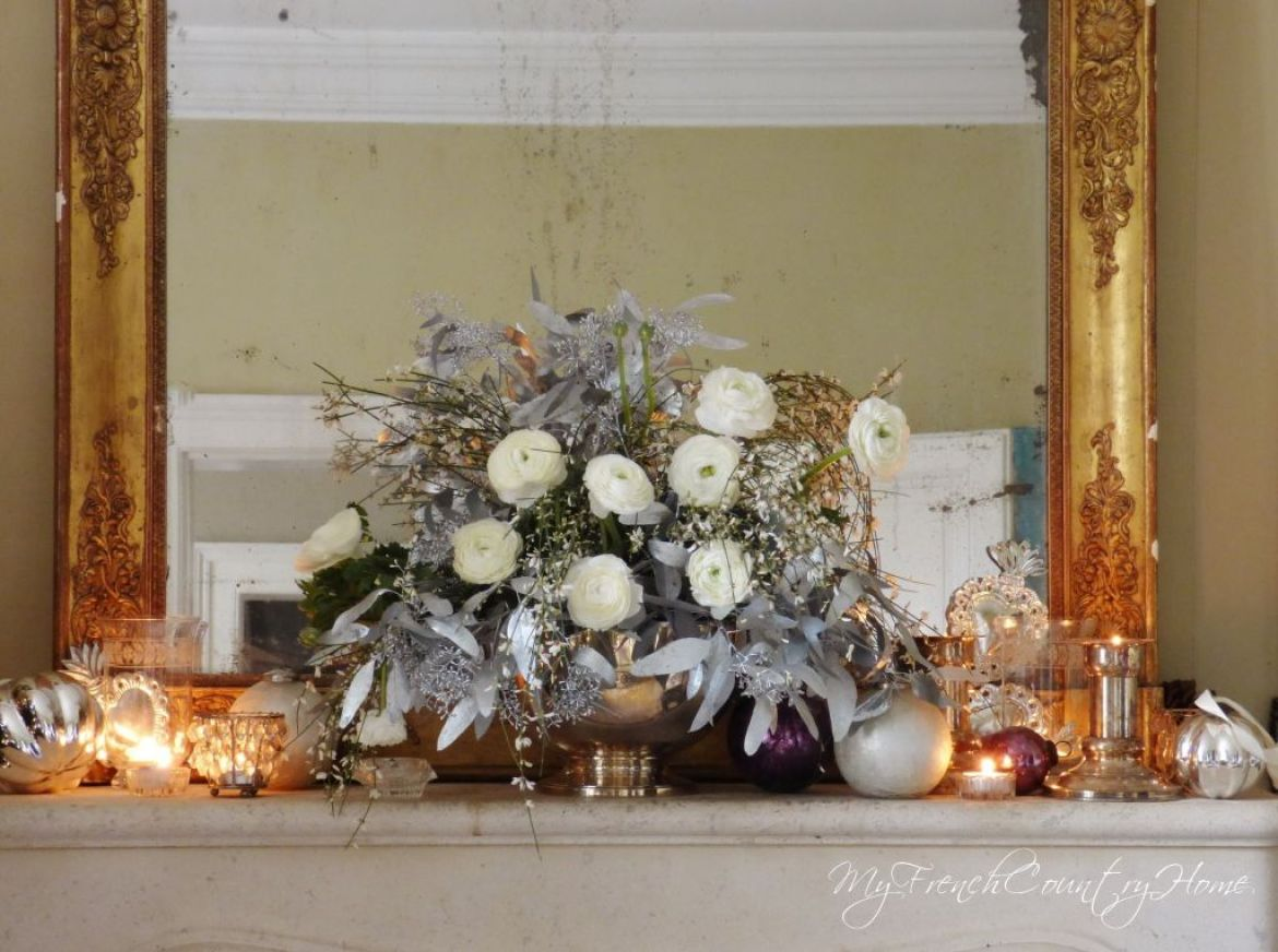 silver and white christmas decoration on french country fireplace