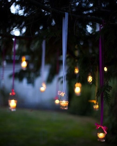 candles hanging from a tree