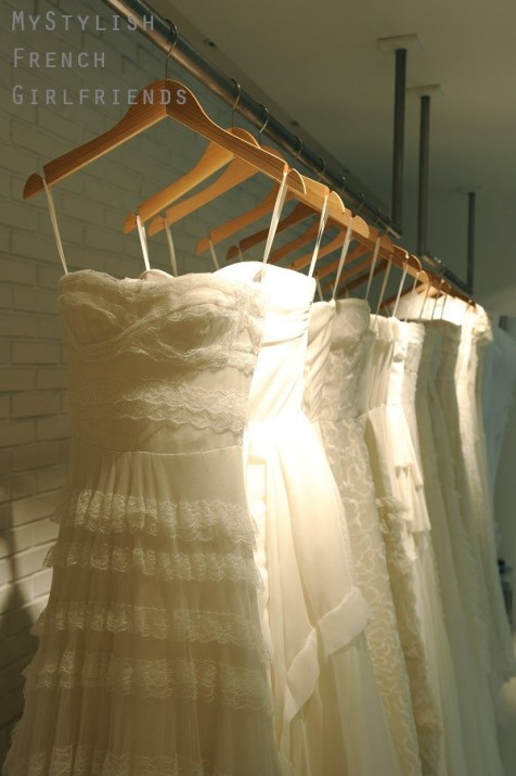 bridal gowns hanging on a rail