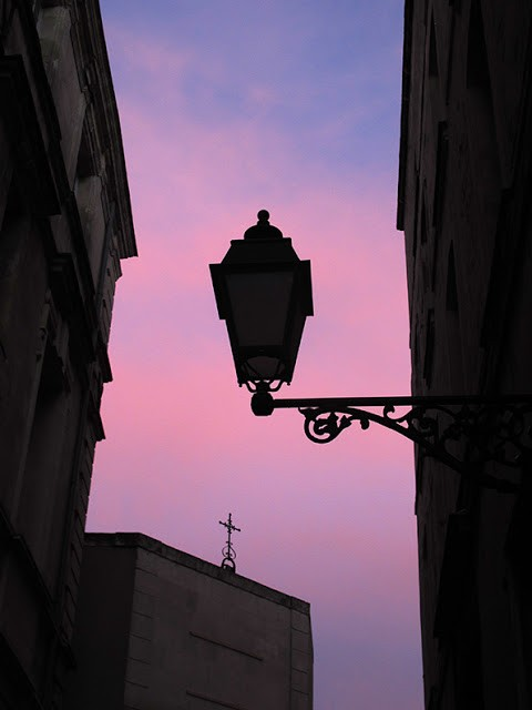 lantern silhouette against pink sky
