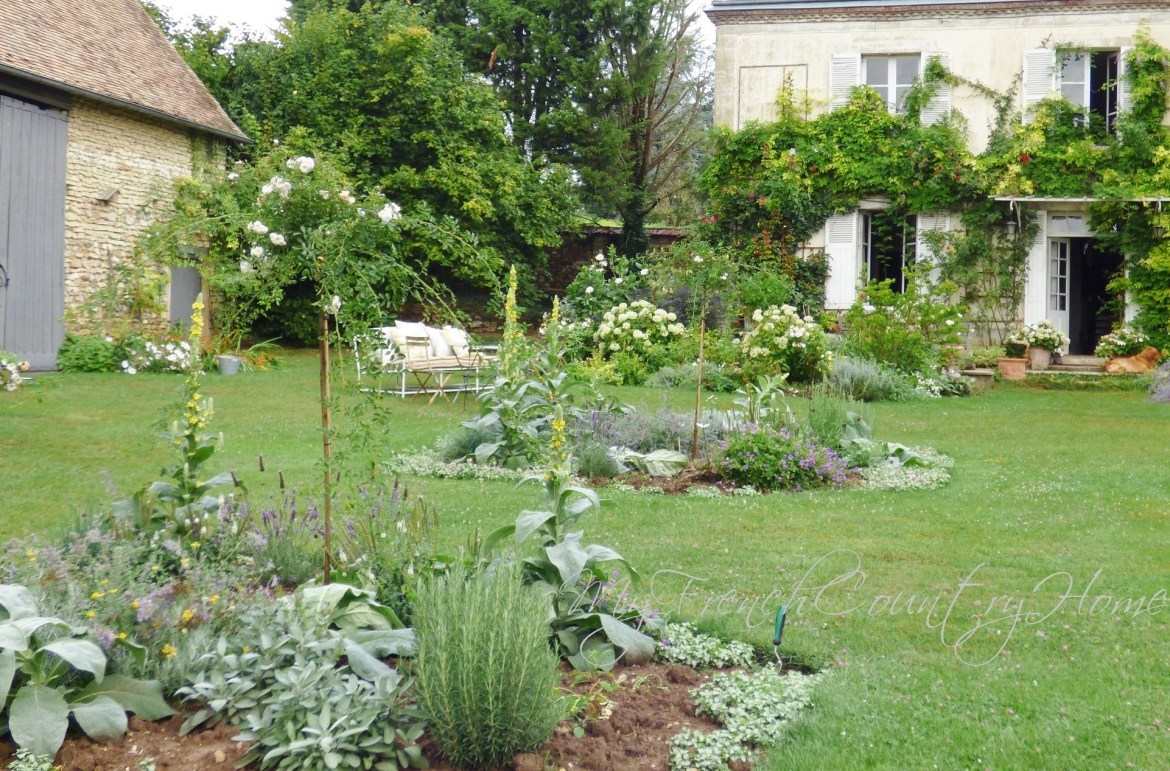parterre beds in front of my french country home