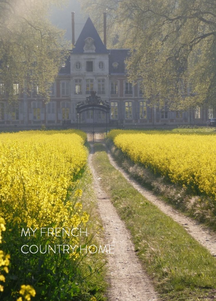 chateau and canola fields in normandy