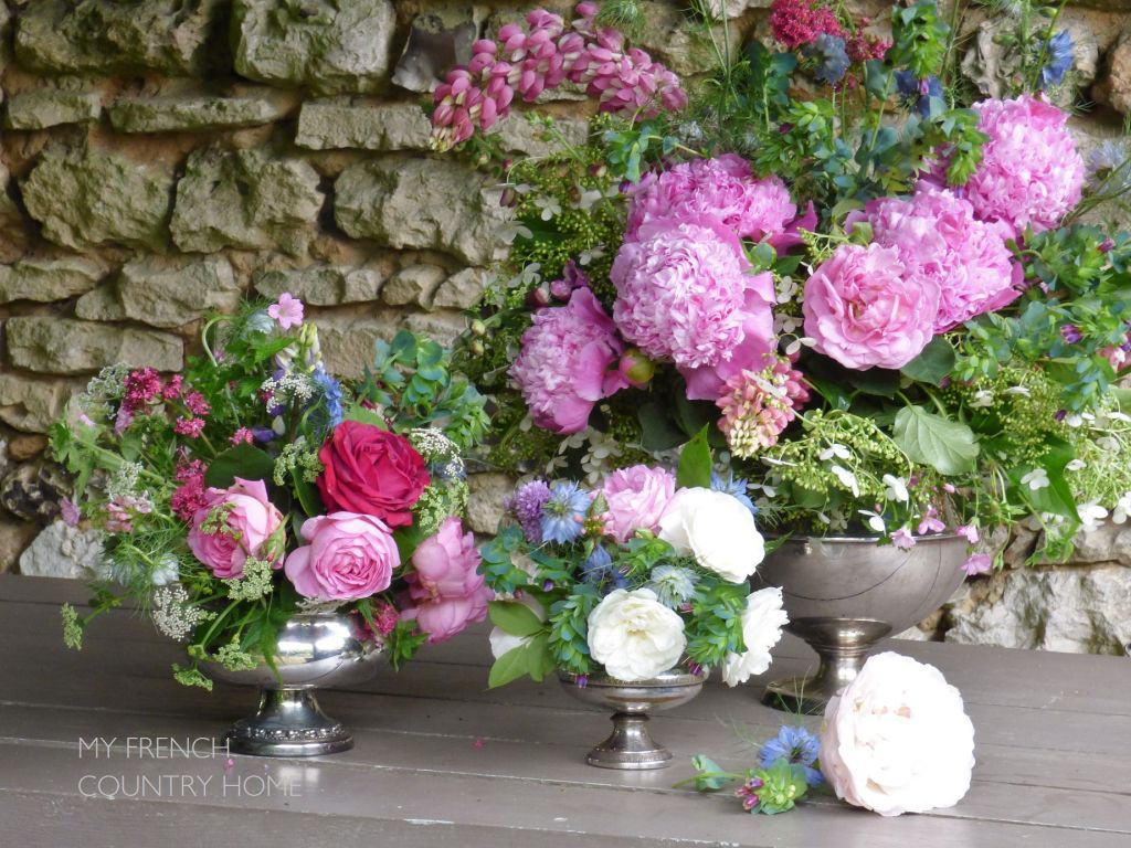 roses and peonies in silver vases