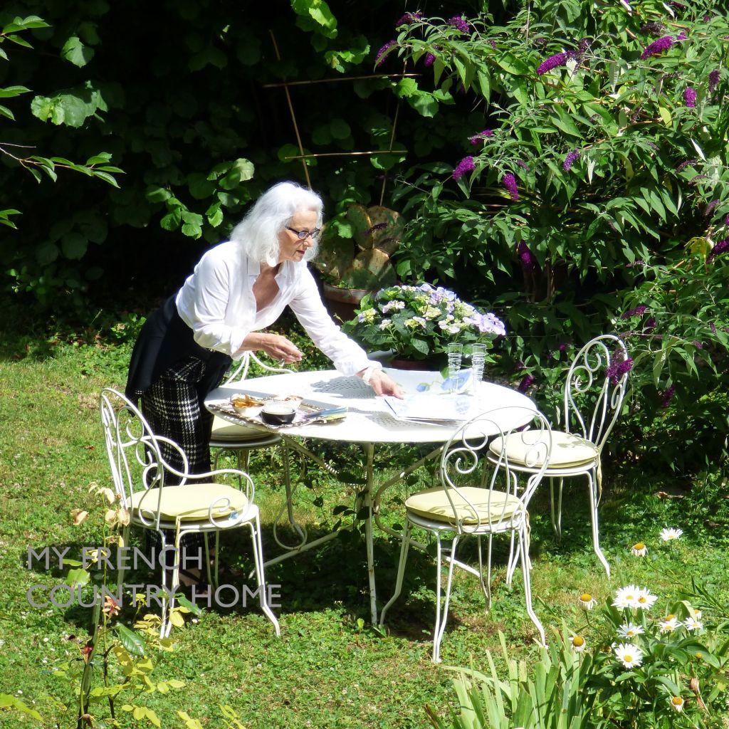 ml daveau queysanne in garden with white table