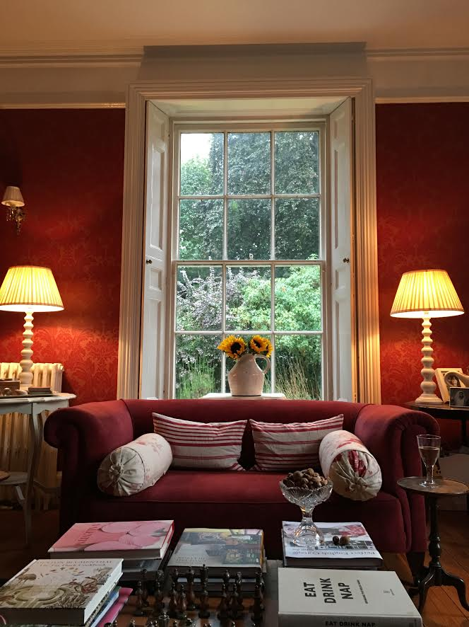 red sofa in front of window with lamps