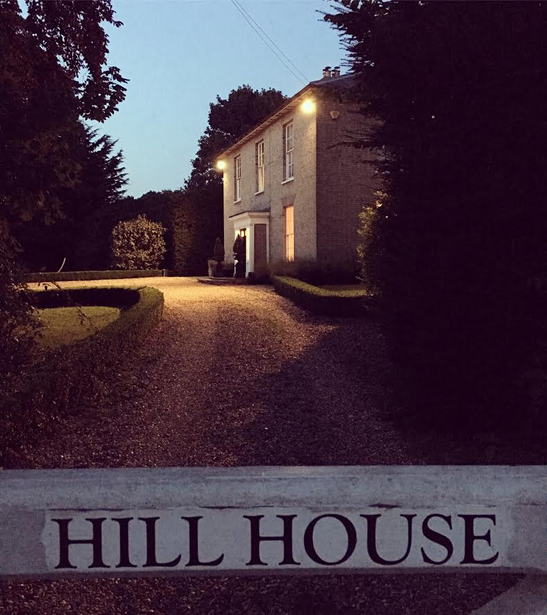 country house lit up at night