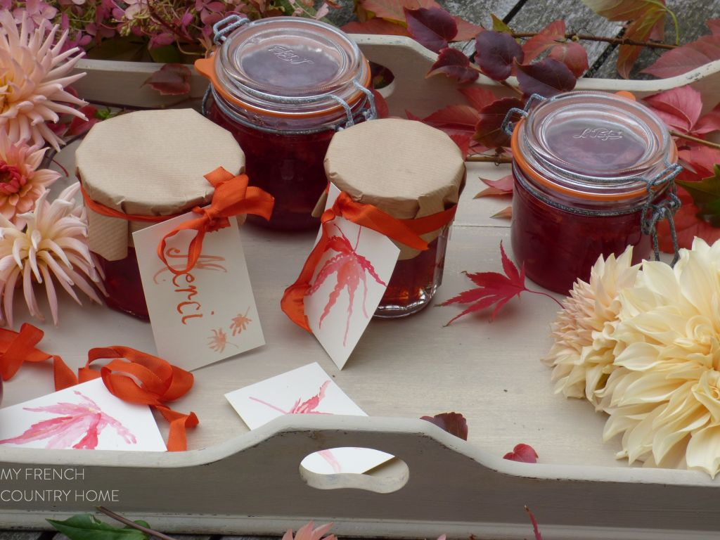 jars o quince jelly on a tray