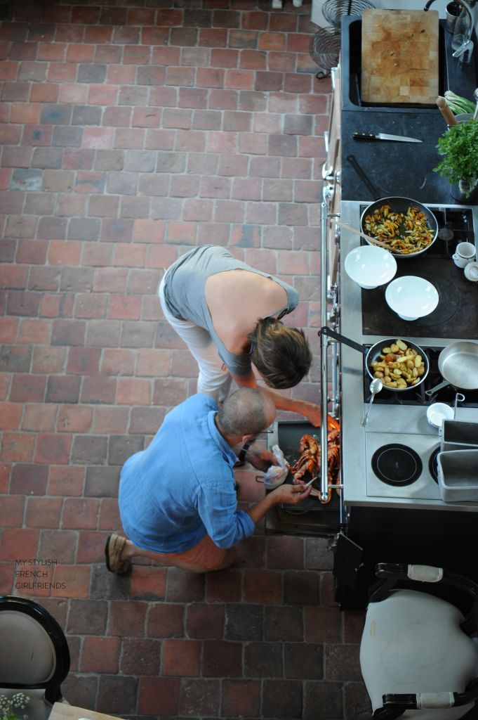 taking food from the oven of a La Cornue stove