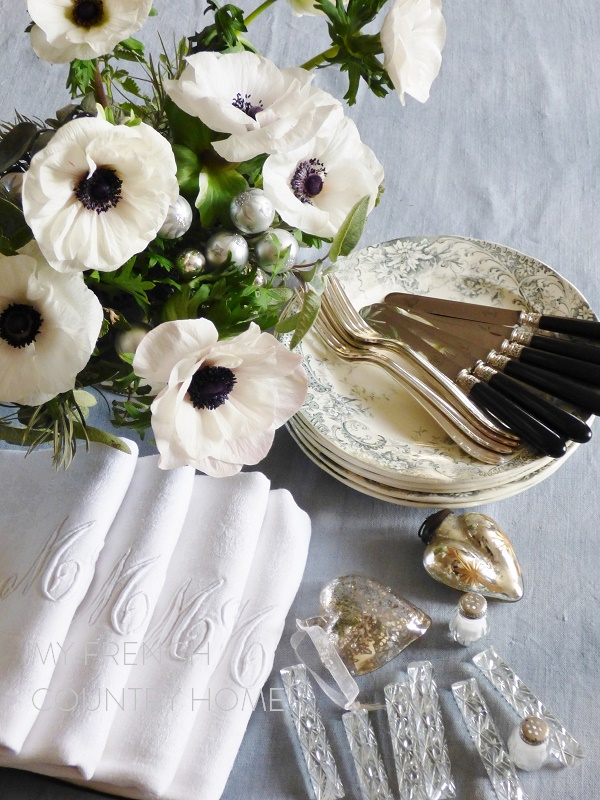 preparing a christmas table in grey