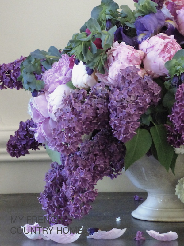 lilac in bouquet with roses and peonies