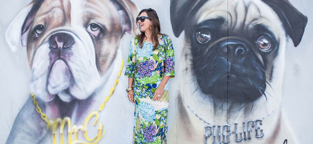 portrait of carla coulson in front of dog wall mural
