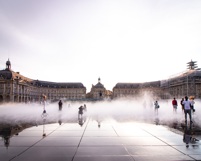 square in bordeaux with mist from fountains