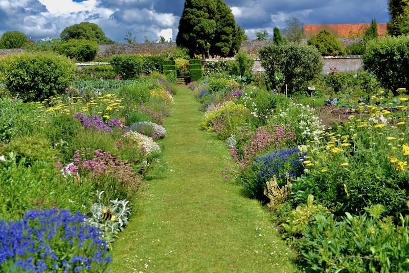 The potager or kitchen garden at Chateau Miromesnil, rows of flowers, herbs, and vegetables