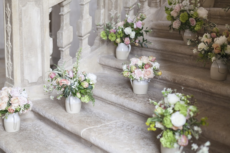 Bouquets on the staircase at Chateau de Moissac | My French Country Home Tours