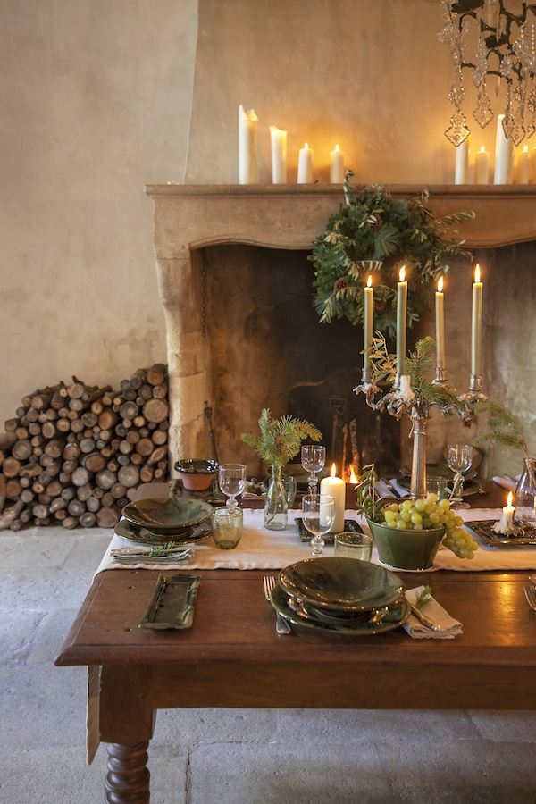 table laid with candles in chateau kitchen