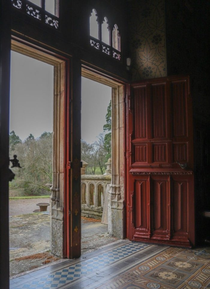 open big red doors in french chateau