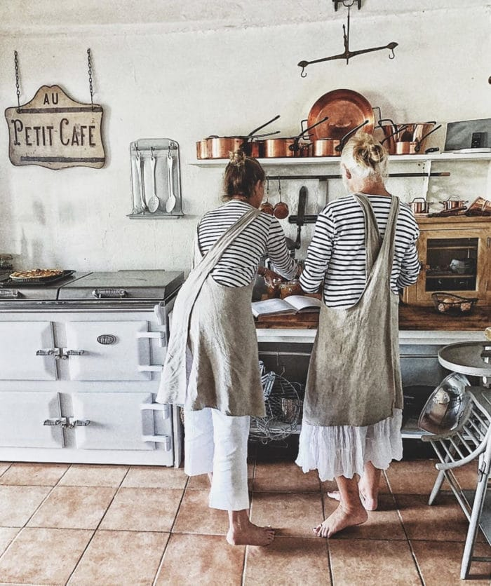 two women cook in the kitchen