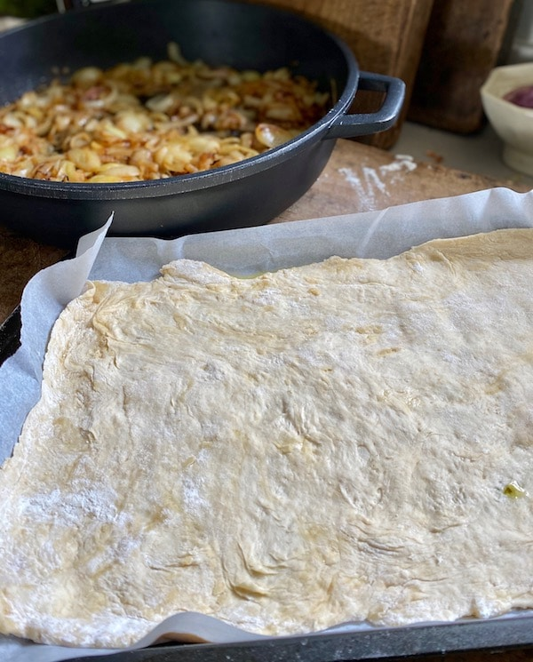 dough and onions ready to make tart