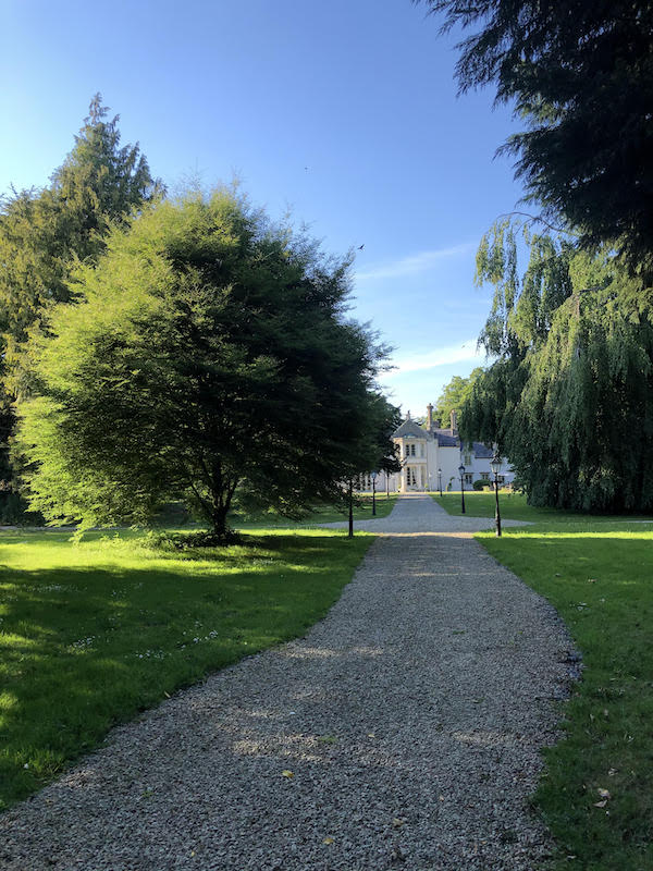 gravel path leading to french manor home