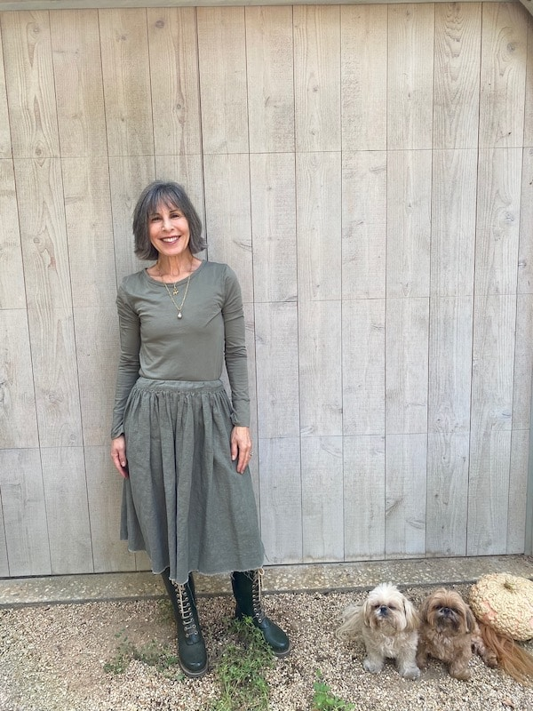 women in grey top and skirt