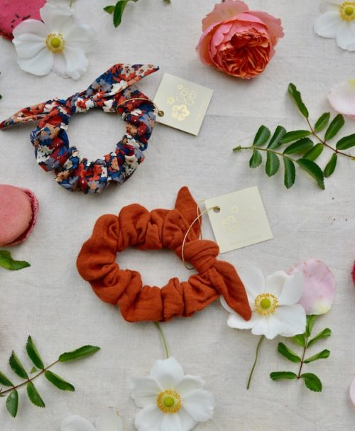 a terracotta-colored and patterned scrunchie