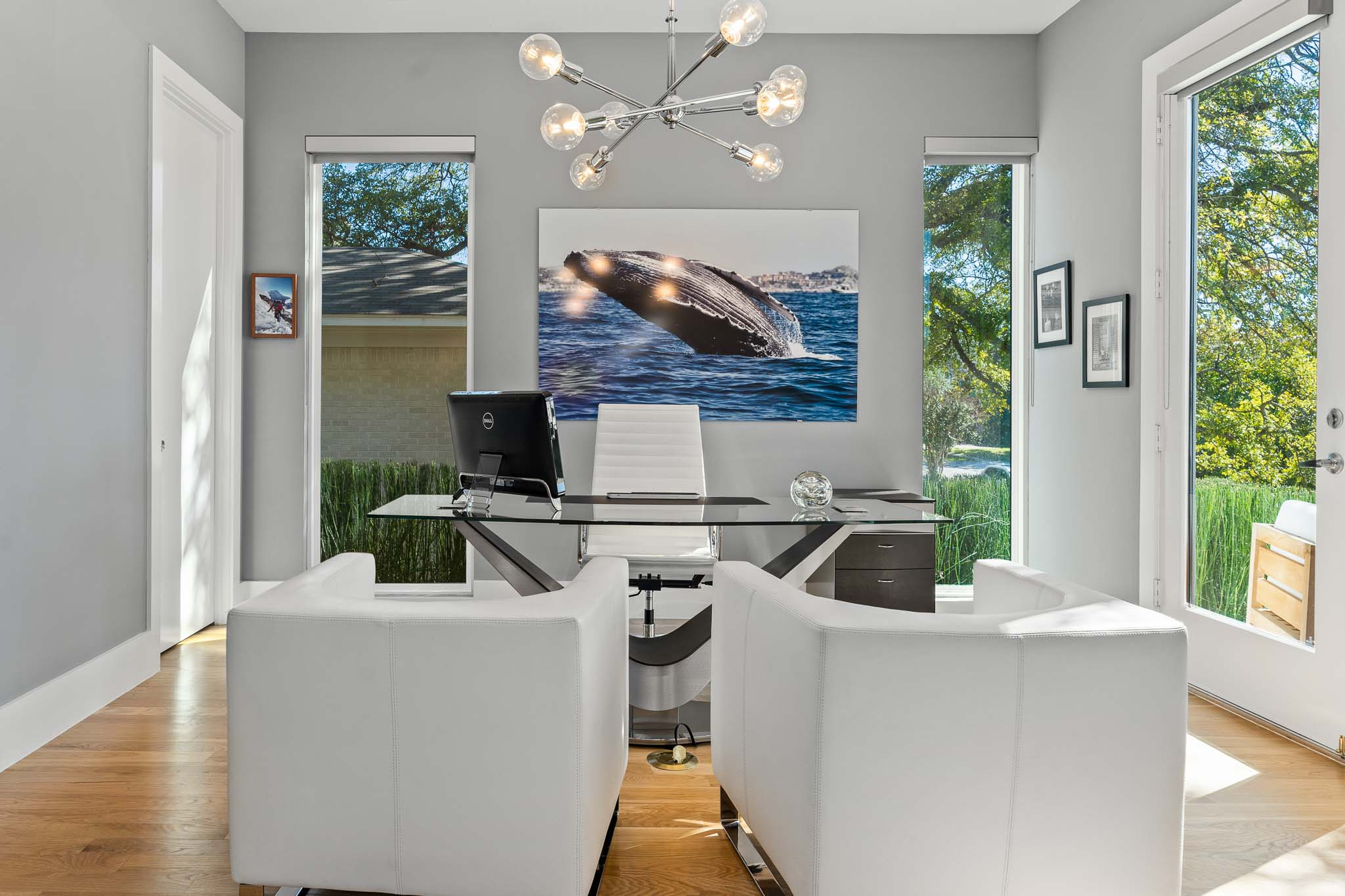 Modern home office with modern lighting and white furniture