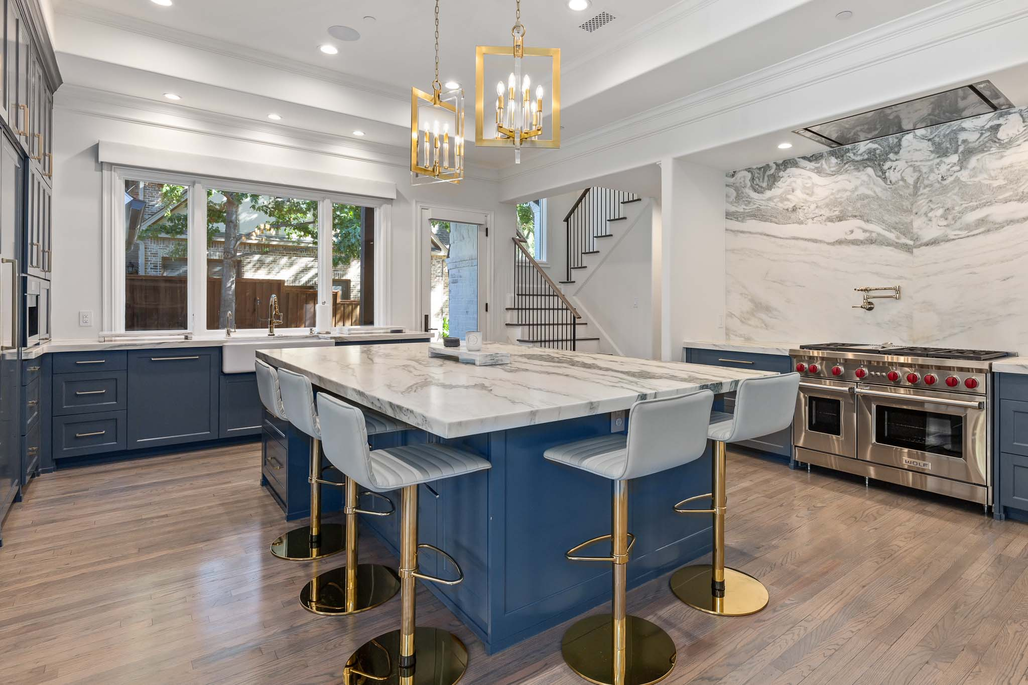 Chef's kitchen with upscale appliances and blue kitchen island