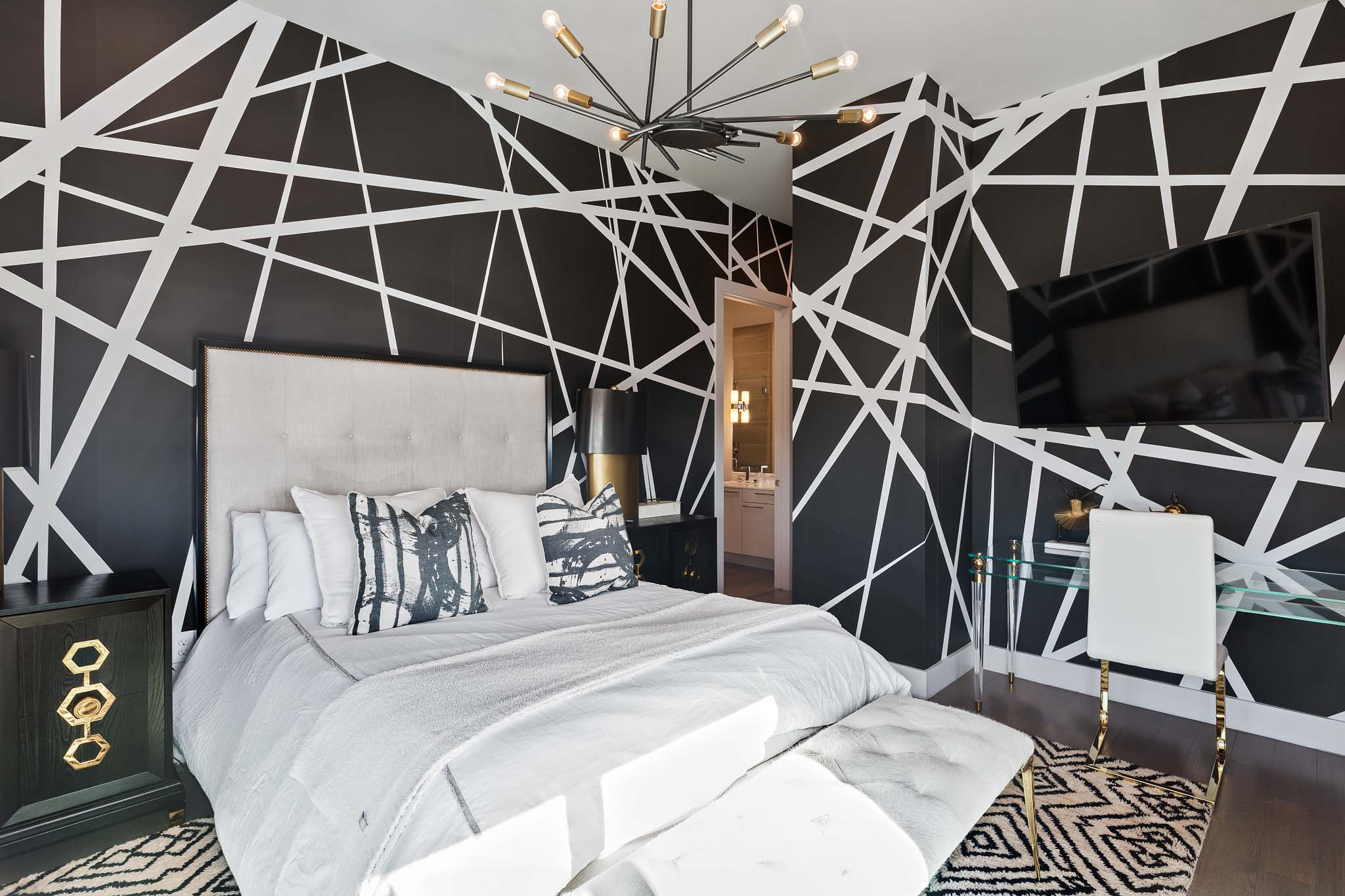 Bedroom in penthouse with black modern accent walls