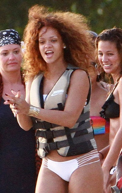 Rihanna Life jacket on beach