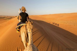 Nothing more romantic than watching the sunset on a camel in Sharqiya (Wahiba) Sands