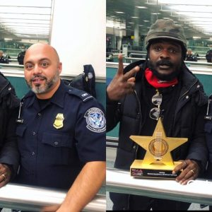 Ras Kukuu carries his VGMAs plaque to USA & greets everyone he sees on the street with it