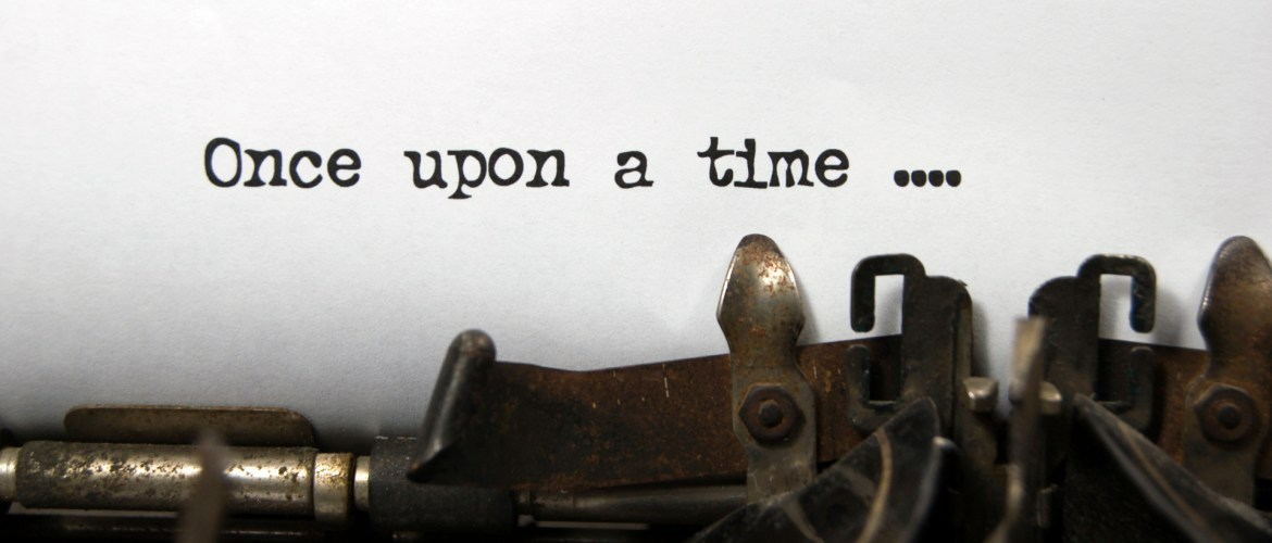 A typewriter holding a sheet of paper upon which are typed the words 'Once upon a time ...'