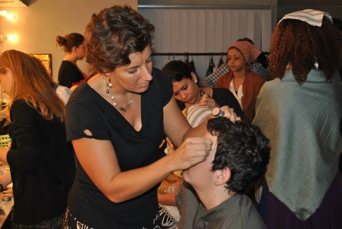 Here I am torturing some poor boy by applying make up. They especially hated the eyeliner.