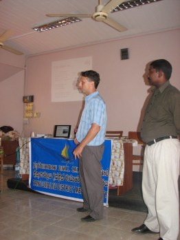 My translator Watiesh and I rip it up in English and Tamil. The Sinhala translator sat in the audience and yelled his translation at the same time we were talking. Wasn't noisy in that room at all! hahaa..