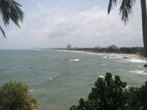 On Sunday we spent the day at the Mt. Lavinia Hotel pool. About a 25-minute tuk tuk ride from our house, this is a view of the beach from the pool. You can see downtown Colombo in the distance.