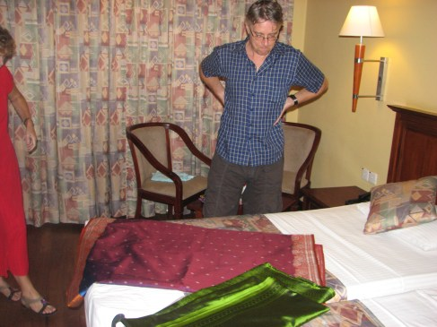 Volunteer Hans inspects the ladies' saris the night before. He approved and may or may not have tried on one of the blouses.