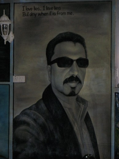 Here is a mural of the man behind the pizzeria. This hangs in his public swimming pool along with the following interesting public safety announcements.