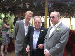 Here Paul is pictured with his father and some other guy who is probably related.