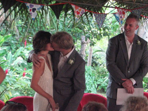 Paul takes the first opportunity to smooch his blushing bride.
