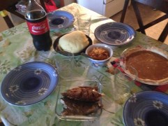 Canadian meets the Congo is this perfect lunch spread of tilapia, ugali, cabbage, tomato sauce, Coke and pumpkin pie.