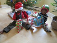 Jesse and Joel didn't know exactly what to do when we gave them their wrapped gifts, but they sure looked great in their hats.