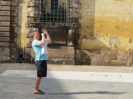 Shaun takes a photo of a cathedral in Lucca.