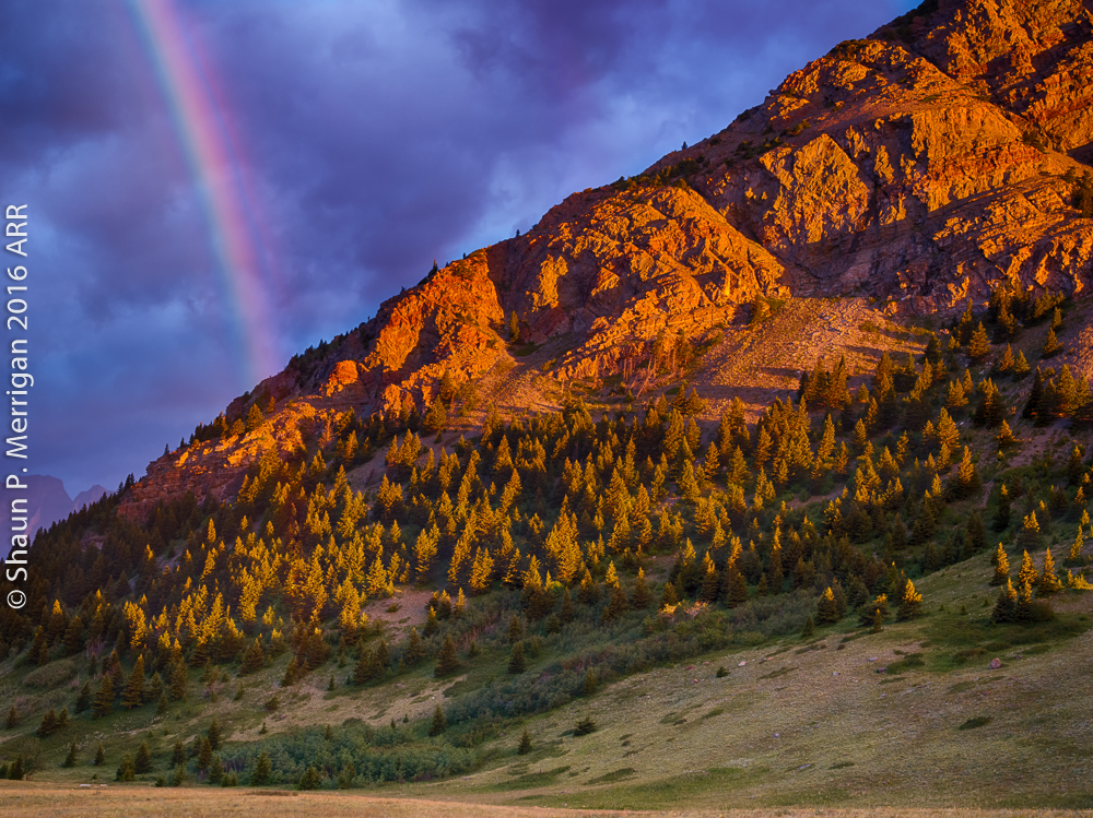 Sunrise rainbow at Waterton Lakes National Park