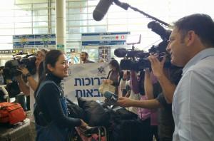 Facing reporters at Ben-Gurion Airport