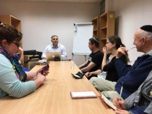 Olga (left) studying with R. Baumol (center)