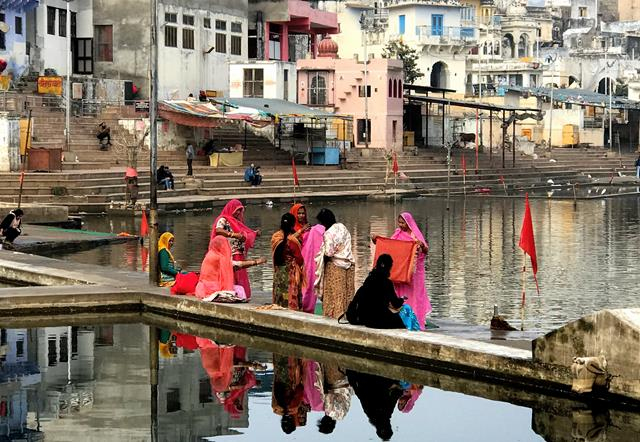Hindus women in a colorful dress at Pushkar Lake