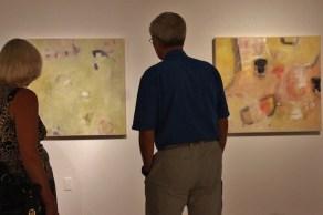 couple admiring contemporary artwork gallery