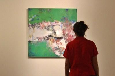woman viewing art show reception
