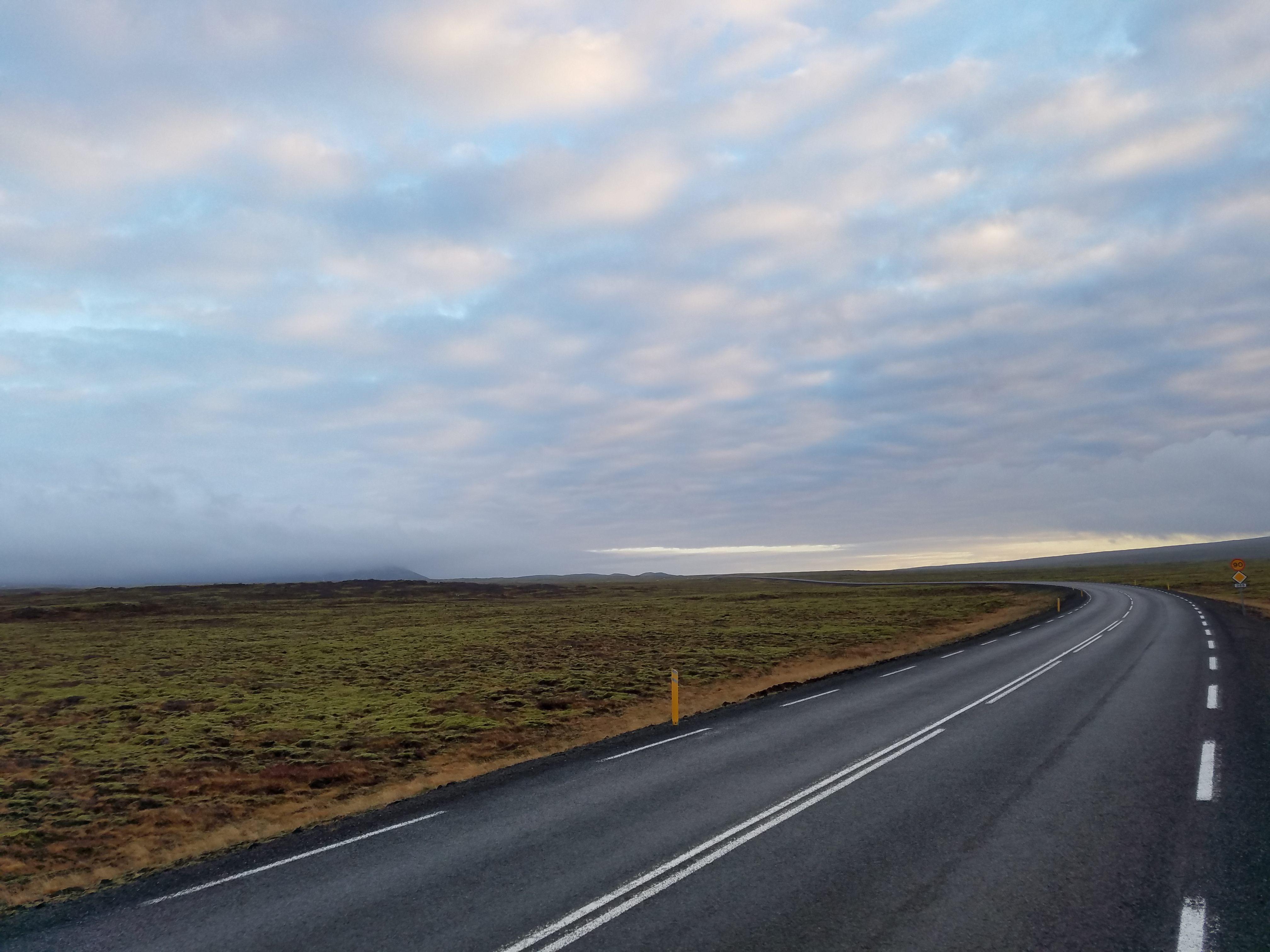 Icelandic road with moss and lava